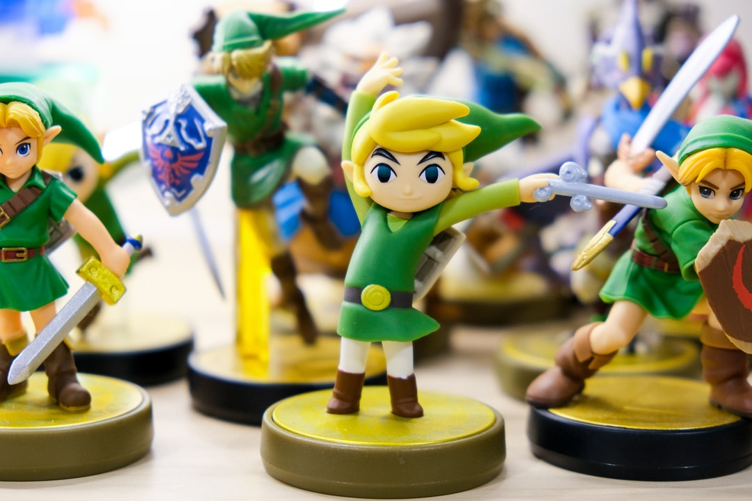 Nintendo amiibo toys of characters of Link from The Legend of Zelda Windwaker, Majors Mask, Ocarina of Time, and Super Smash Brothers