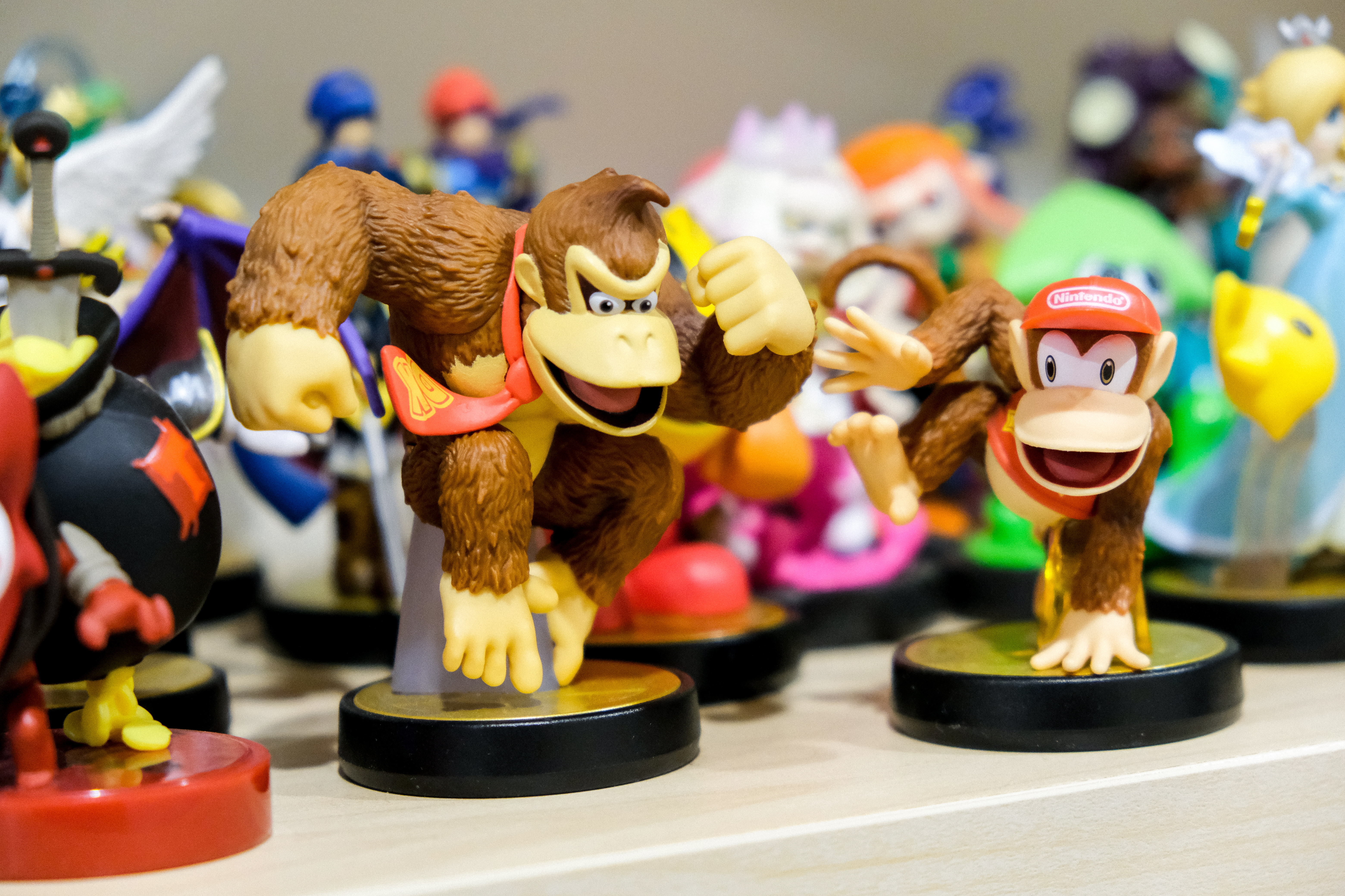 Nintendo amiibo toys of characters of Donkey Kong, and Diddy Kong along with various characters from other franchises.