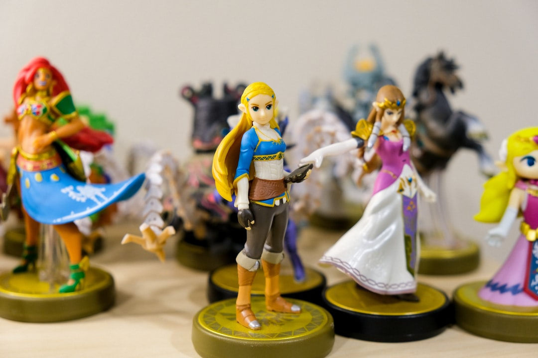 Nintendo amiibo toys of characters of Princess Zelda from The Legend of Zelda Breath of the Wild, Ocarina of Time, Windwaker, along with a Guardian and Urbosa