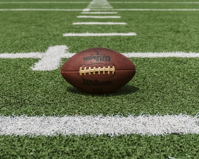 New York Giants, brown and black Wilson football