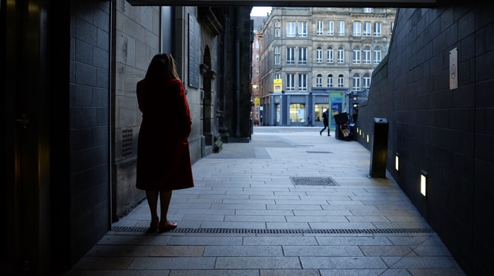 Woman in the Red Coat