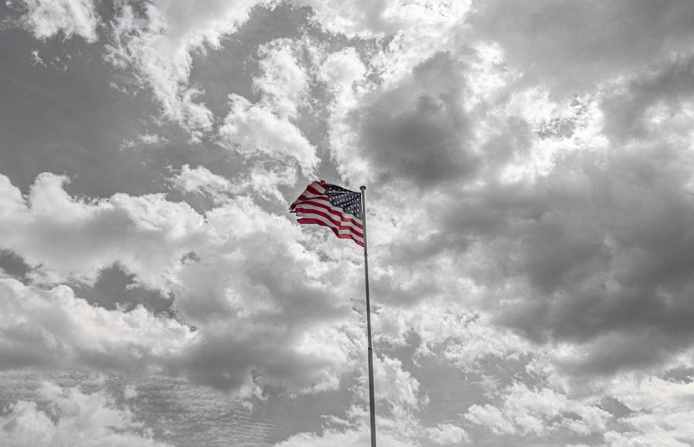 USA flag under grey clouds