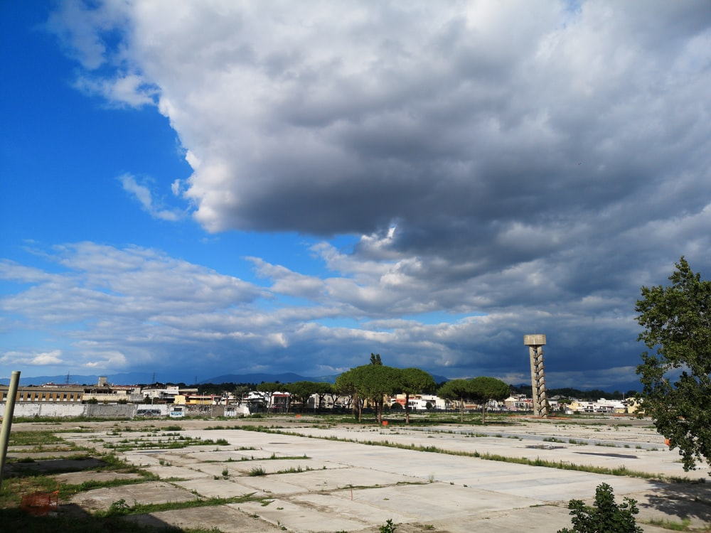 building lot under white clouds during daytime