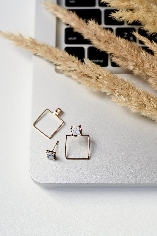 gold earrings on MacBook