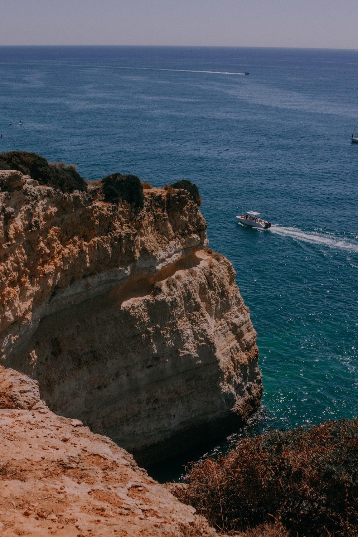 motorboat near cliff