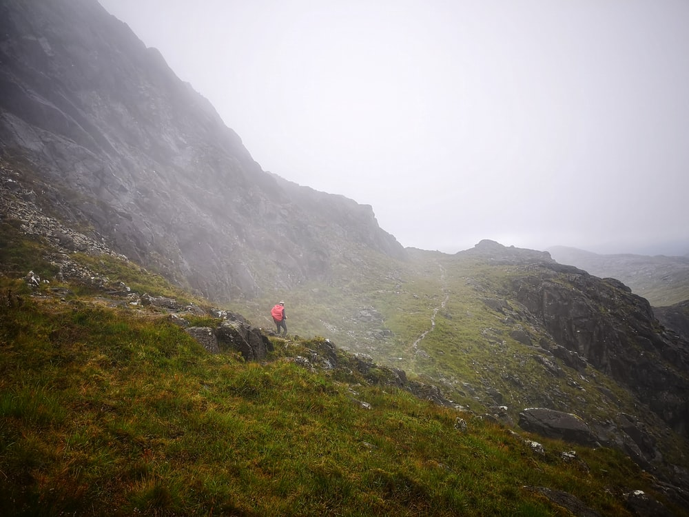 man on hill with fog