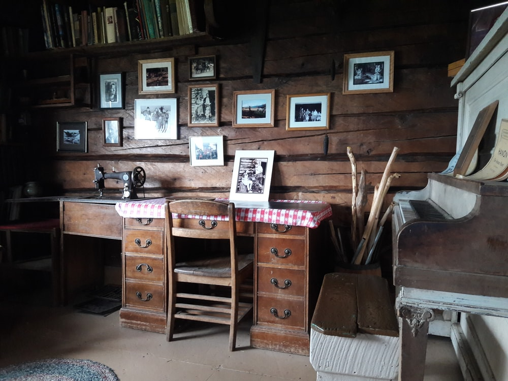 brown wooden desk and chair inside room