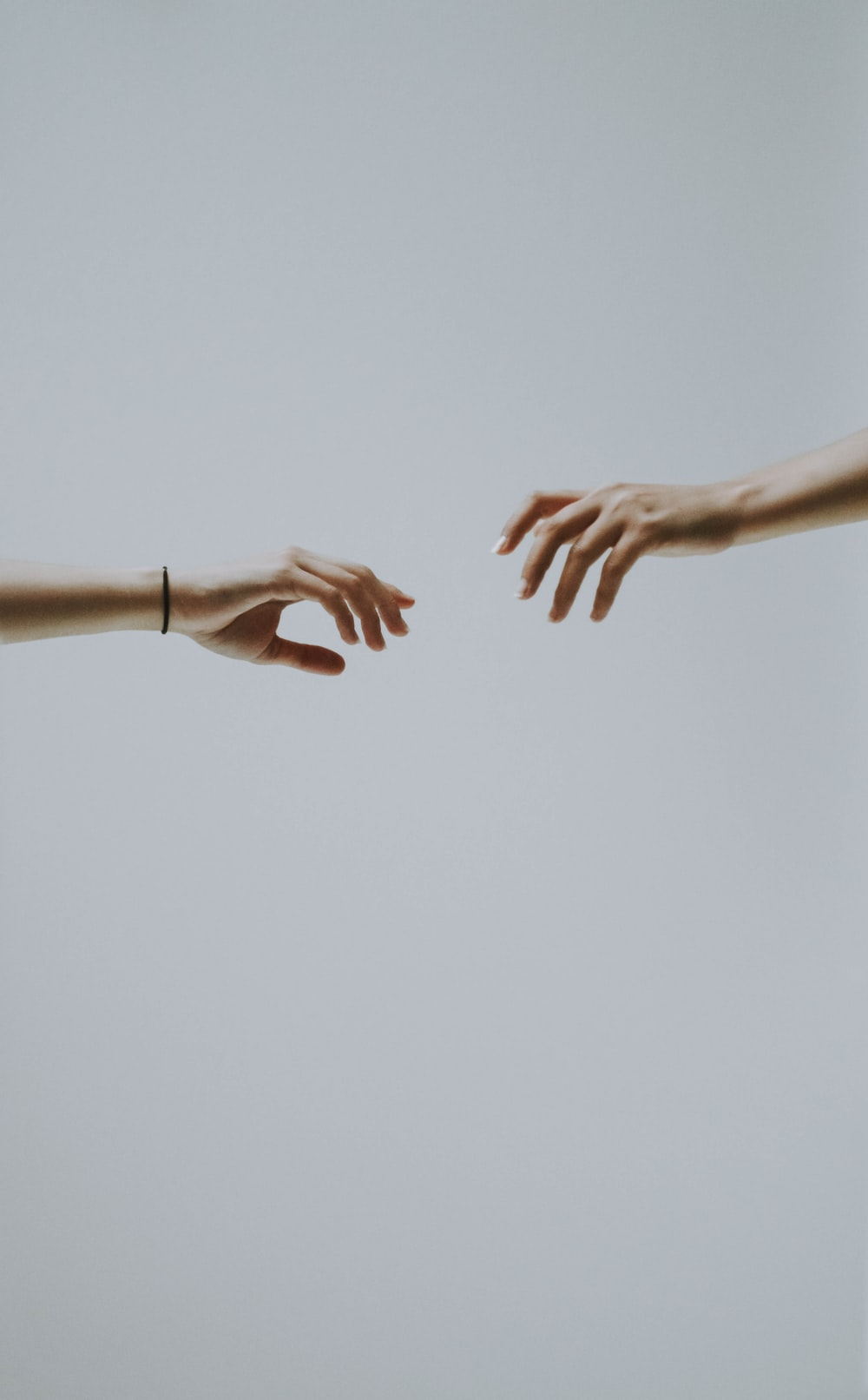 two hands about to hold wallpaper
