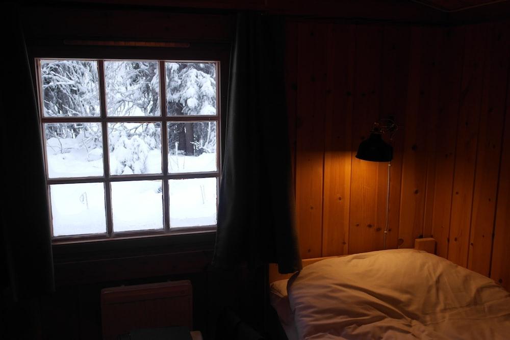 empty bed beside window