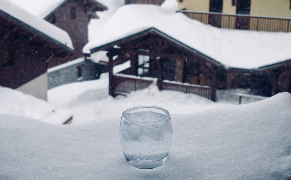 clear glass cup near brown mountain