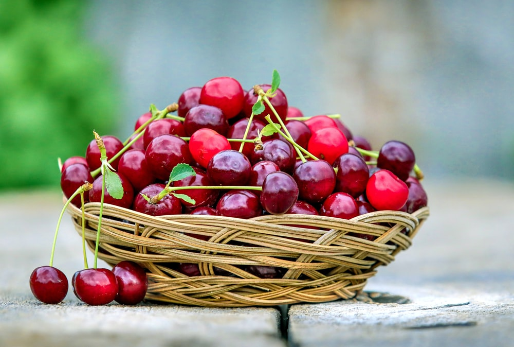 red cherries in basket