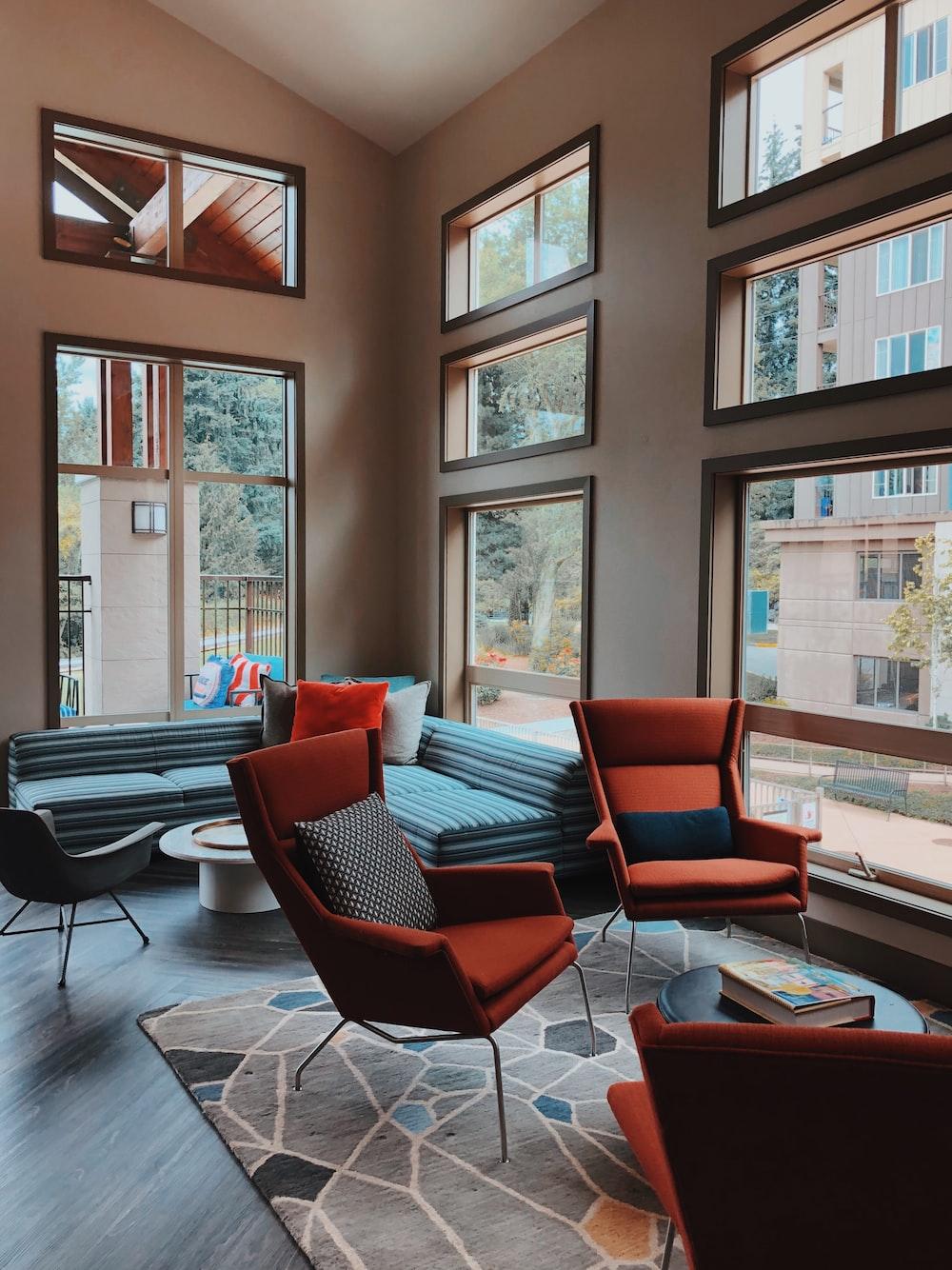 two orange sofa chairs inside room