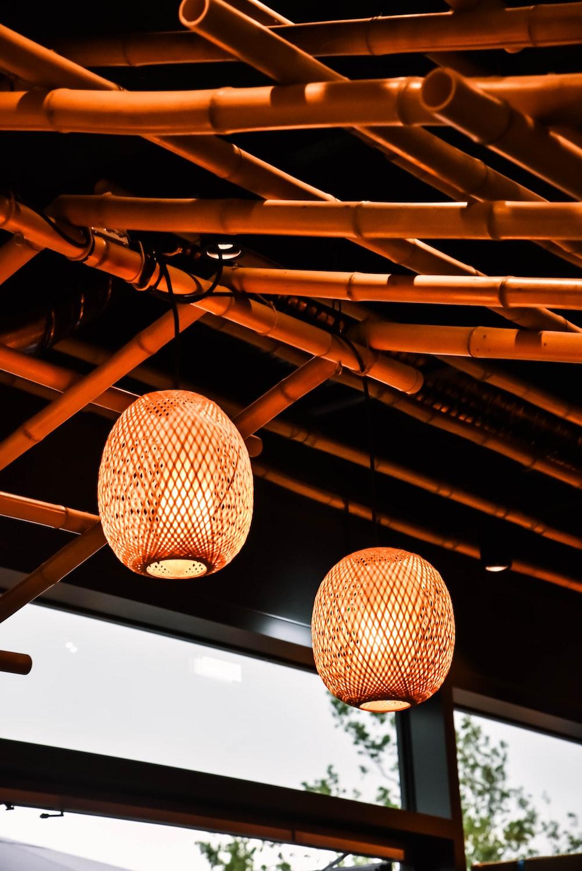 two brown lantern lamps