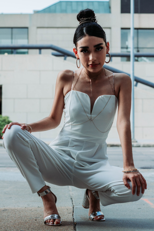woman wearing white spaghetti strap jumpsuit