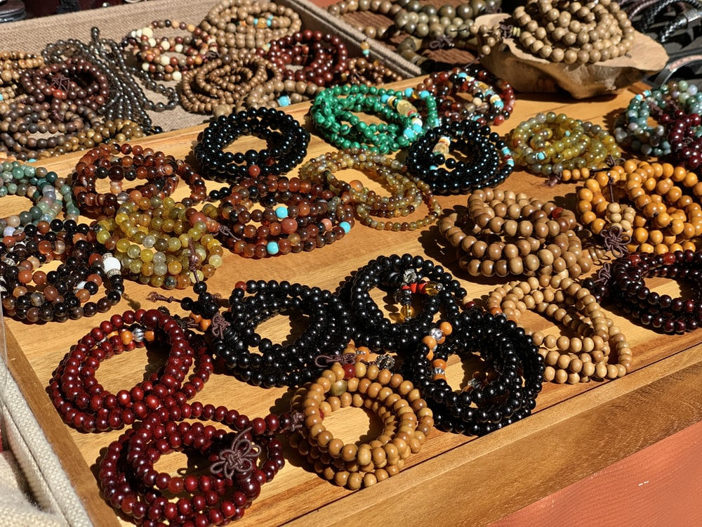 assorted-colored beaded necklaces on display