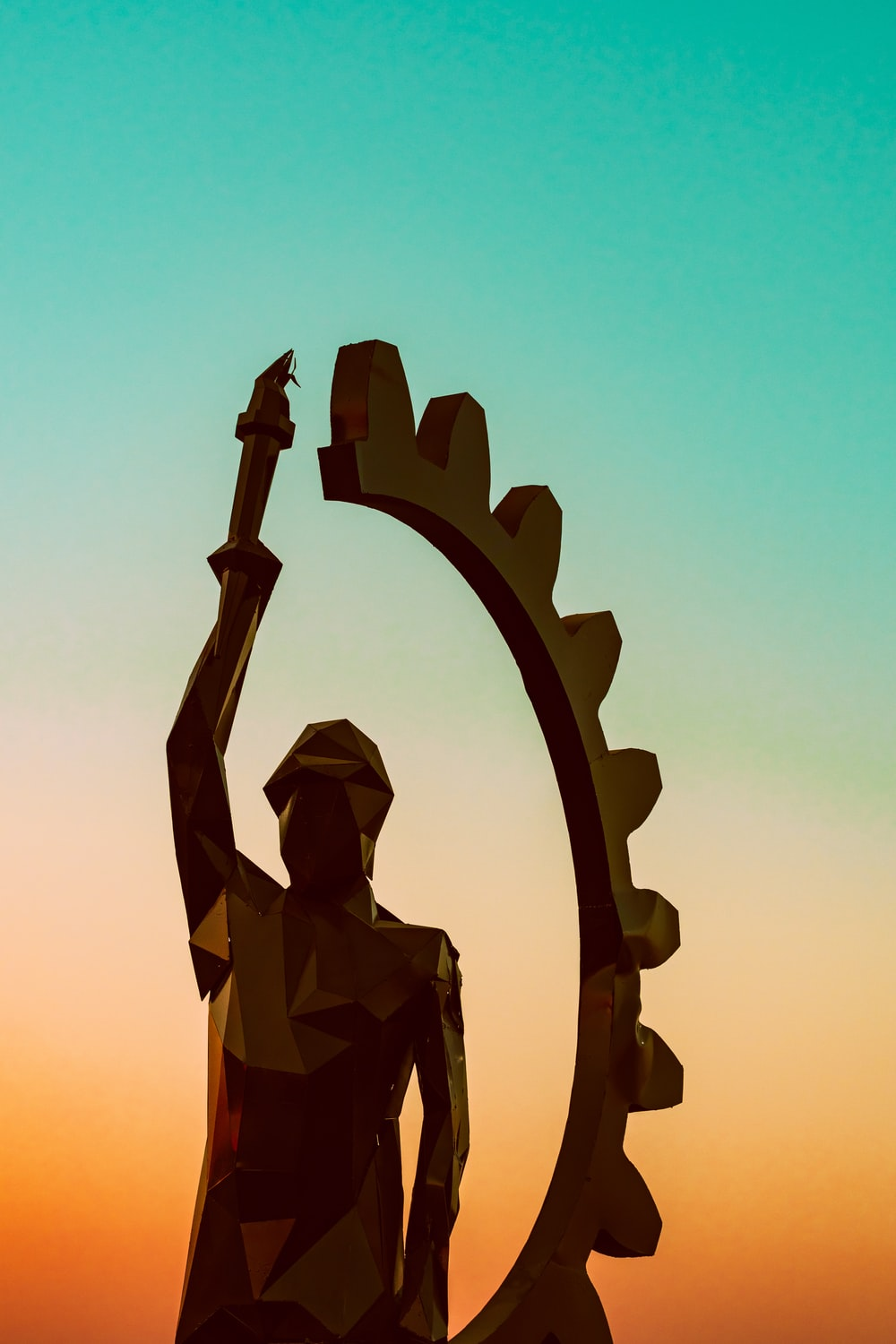 person holding torch statue