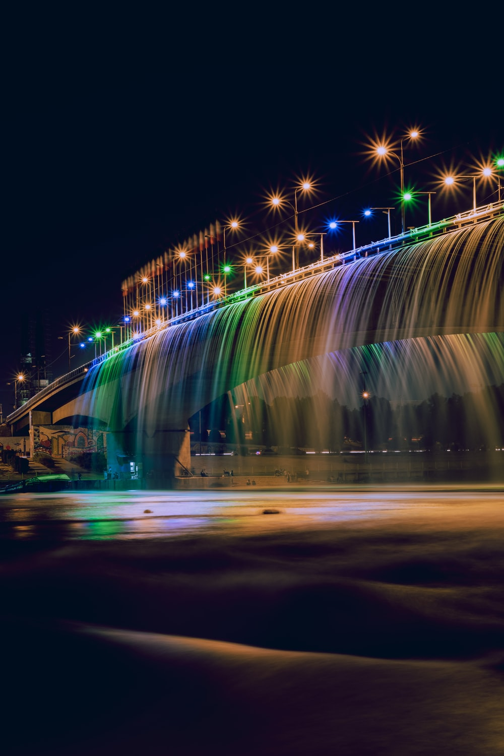assorted-colored LED lights on gray concrete bridge