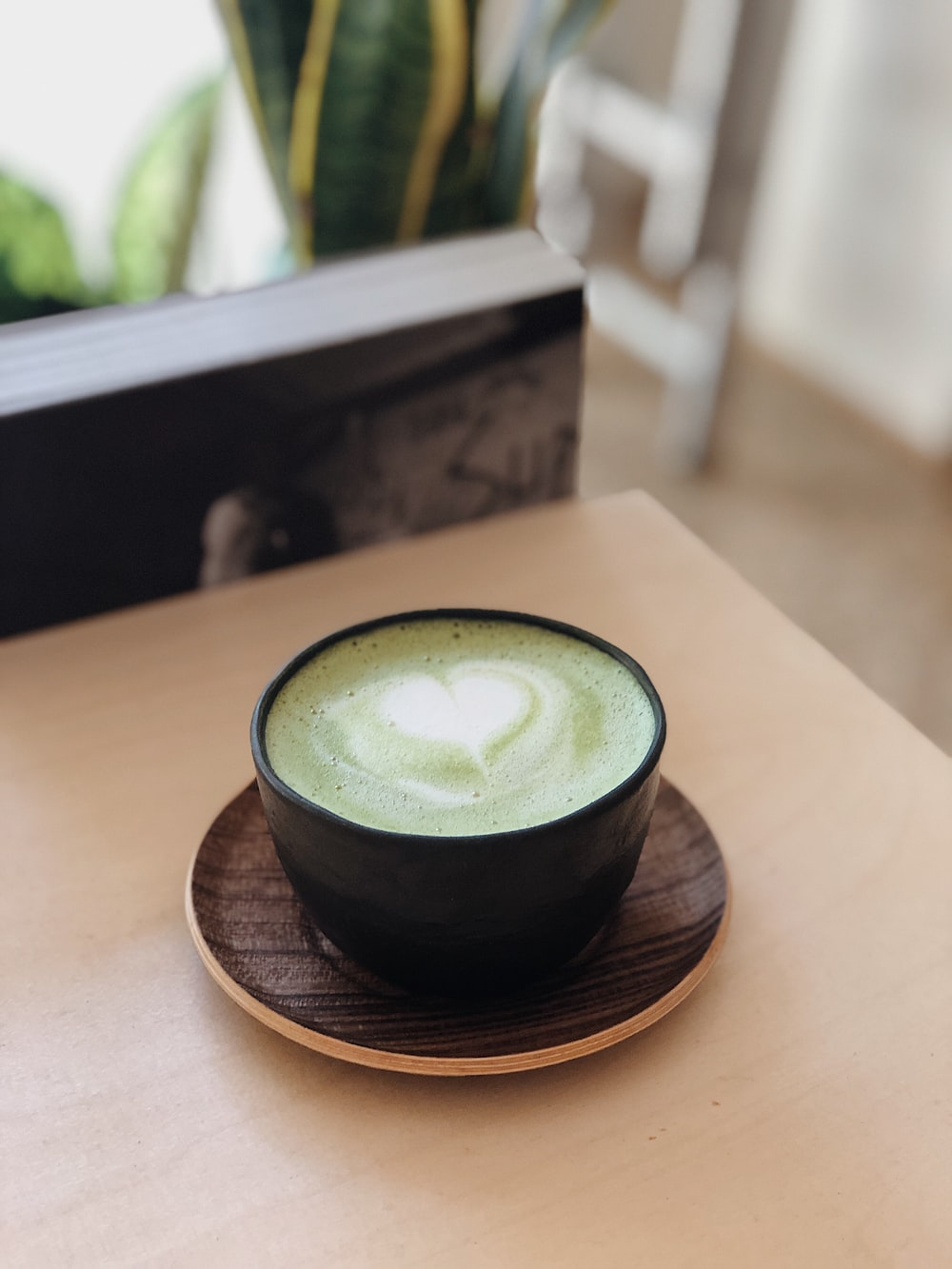 black ceramic cup with brown saucer