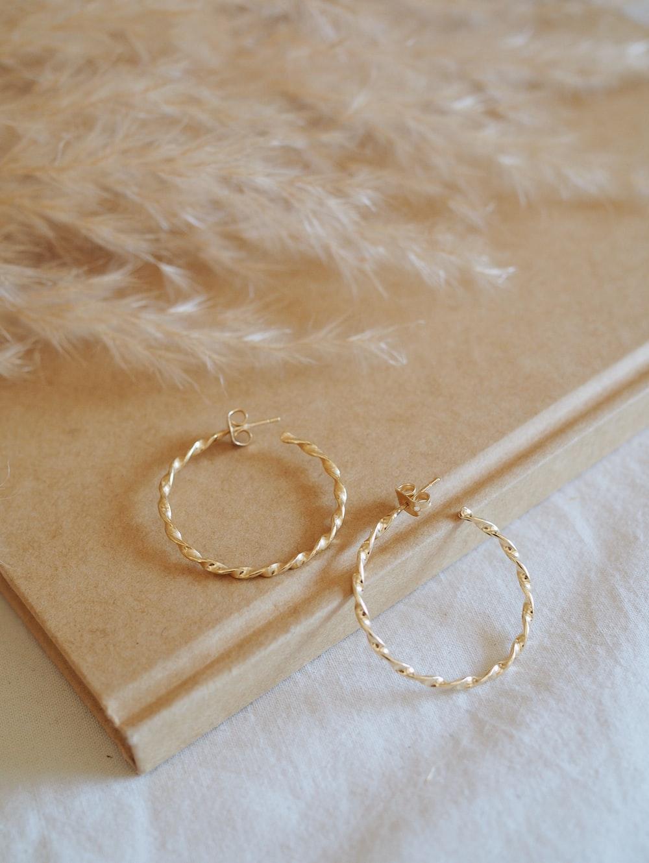 pair of gold-colored hoop earrings