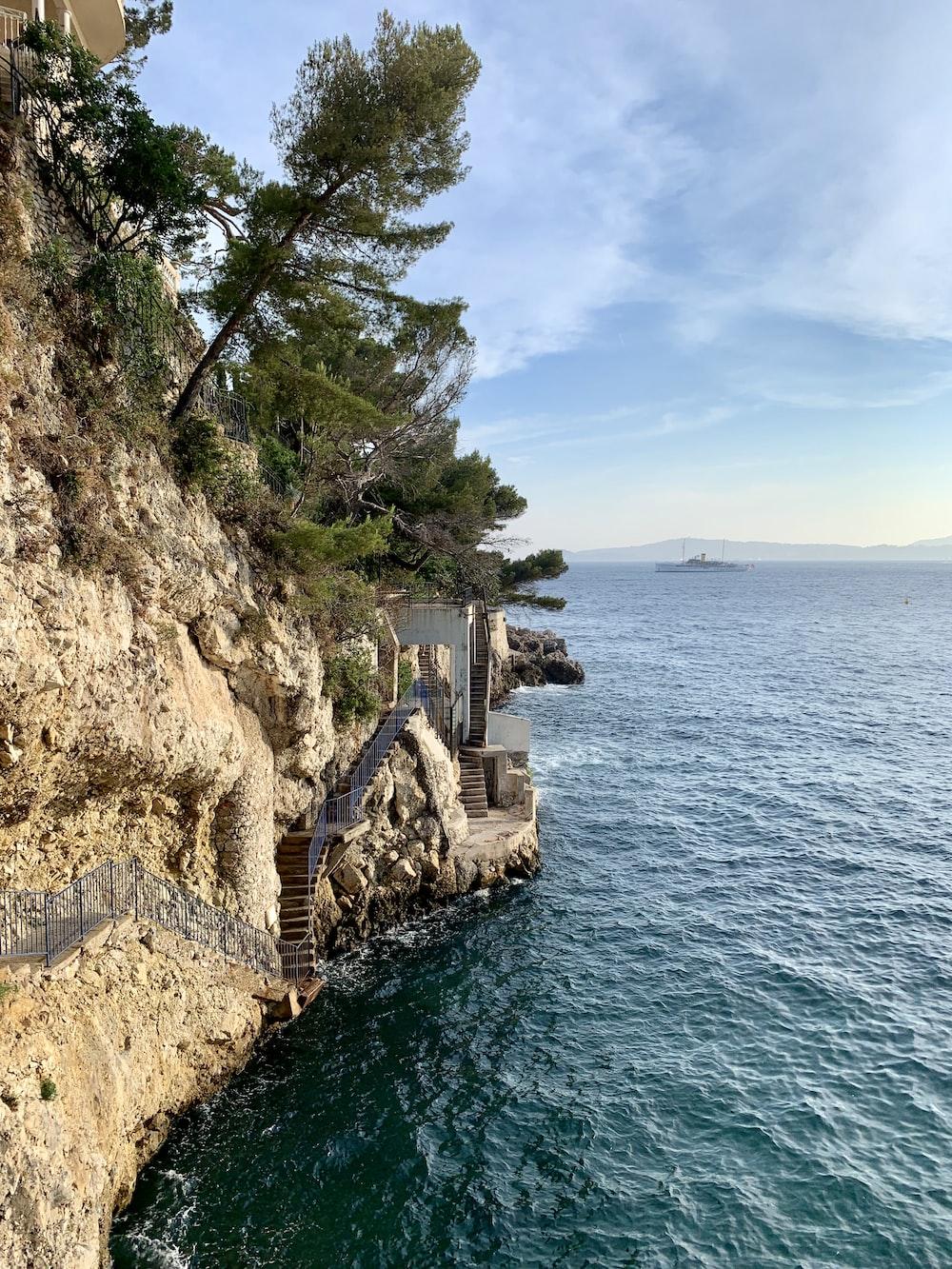 white concrete structure on cliff