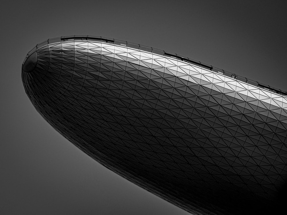 grayscale photography of a blimp