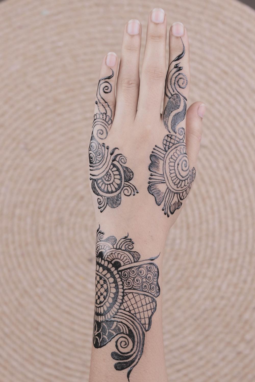 black hand mehndi tattoos
