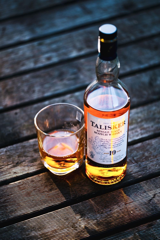 Talisker bottle beside drinking glass
