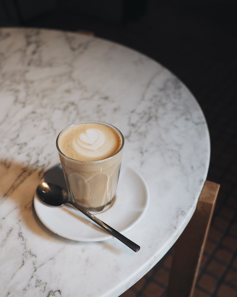 cup of latte on white saucer