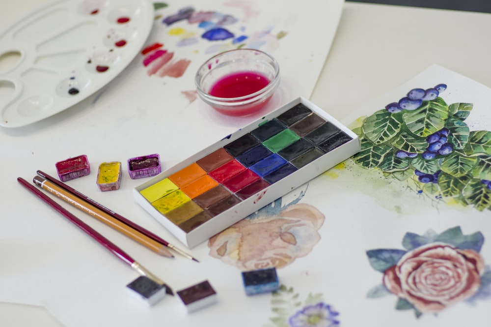 water color palette on white surface