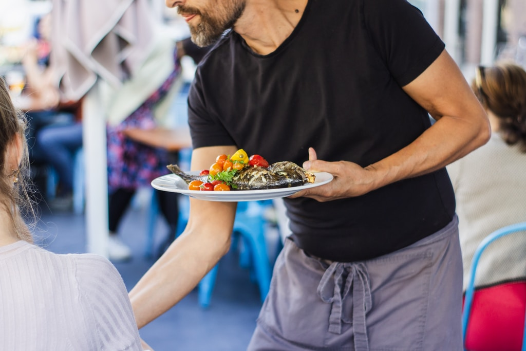 man standing and holding plate
