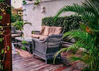 gray woven patio set near plants