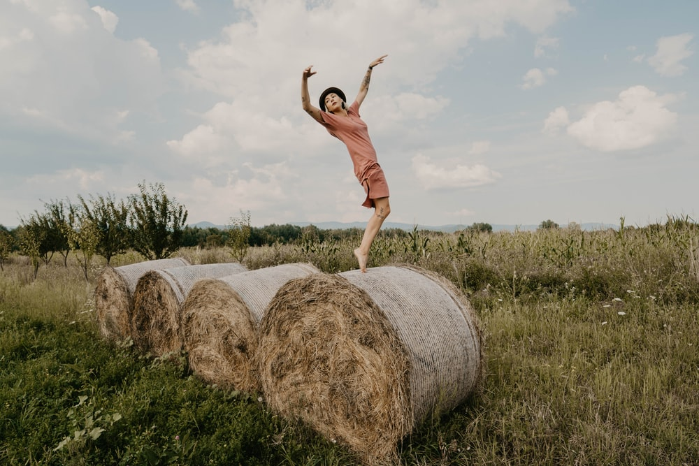 man standing on hay