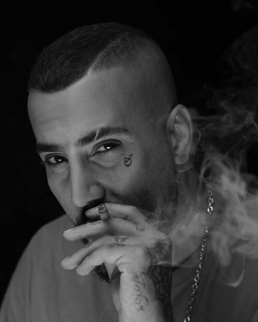 grayscale photo of man smokes