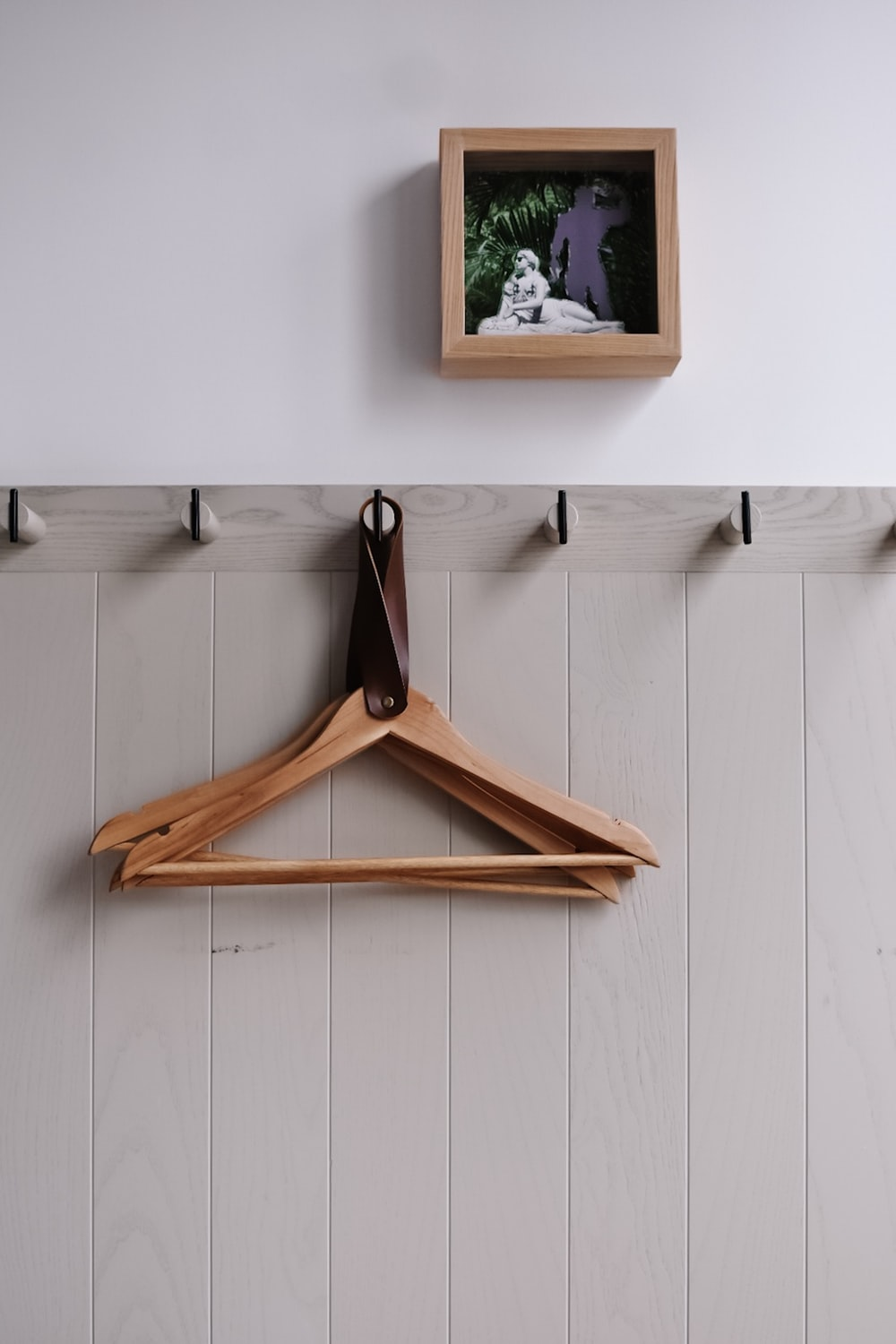 hanged brown wooden clothes hangers
