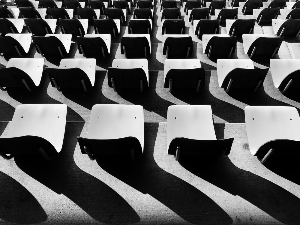 grayscale photography of chairs with no people