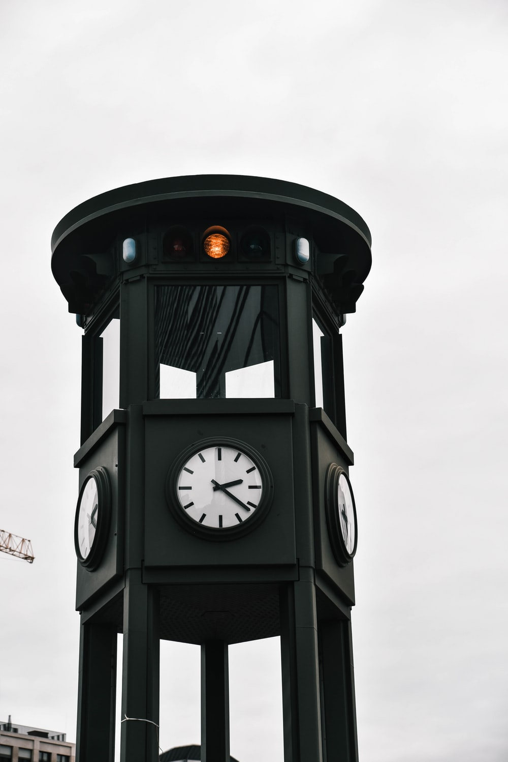 black and gray clock under clear blue sky