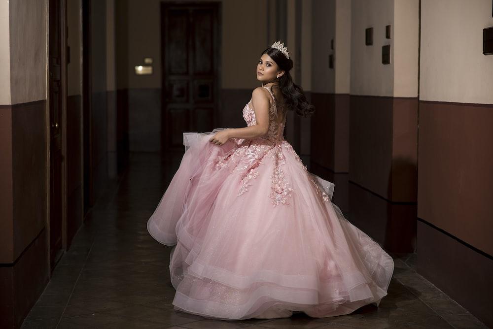 woman wearing pink dress
