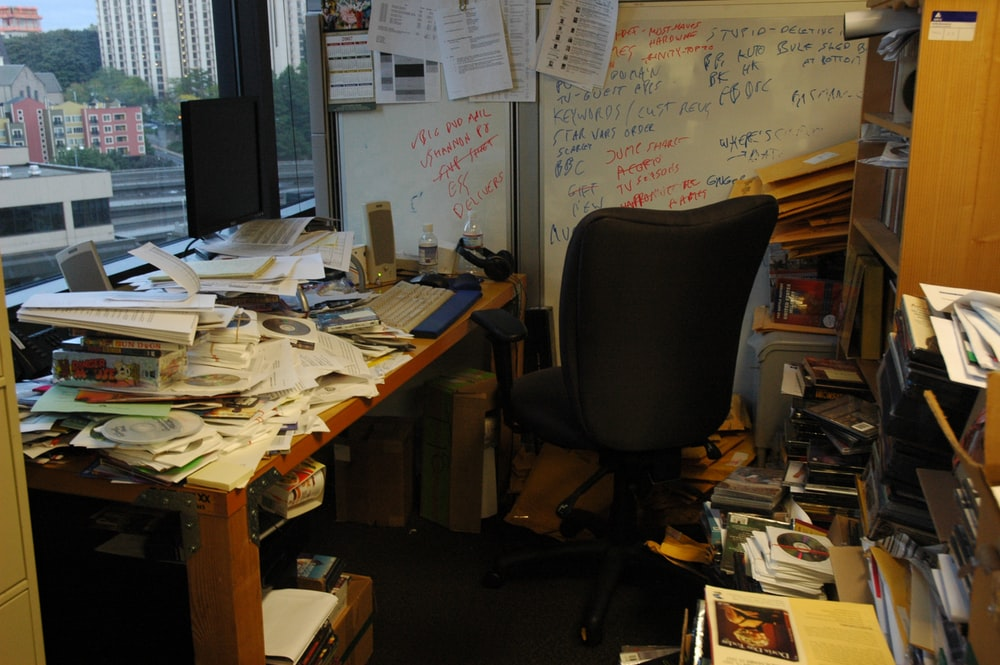 office table with pile of papers