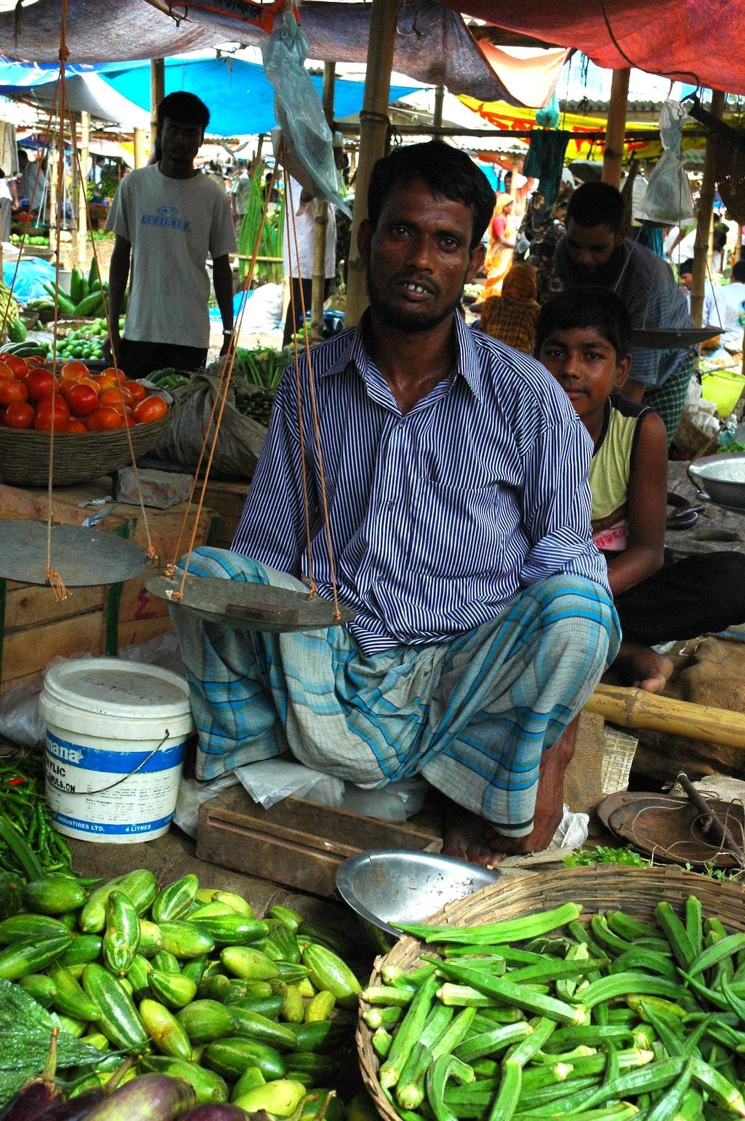 Market vendor, scales, okra, eggplant, squash, green beans, vegetables, market, near the airport, Dhaka, Bangladesh