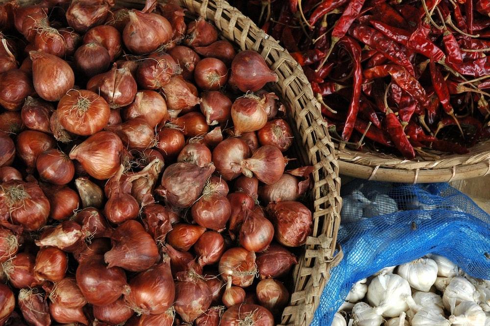 onions in brown basket