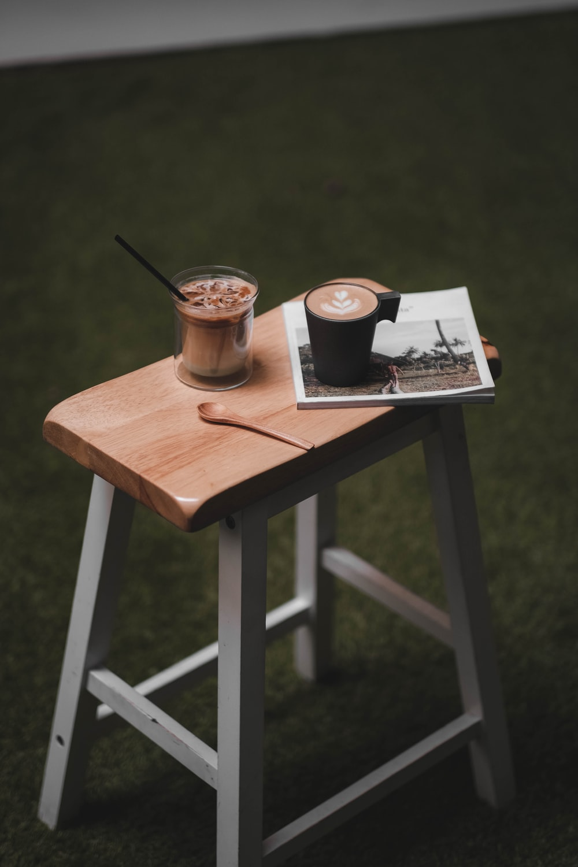 brown ceramic mug on chair
