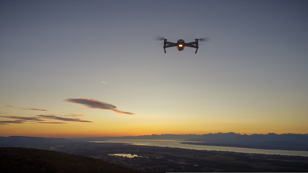 drone in mid air during golden hour