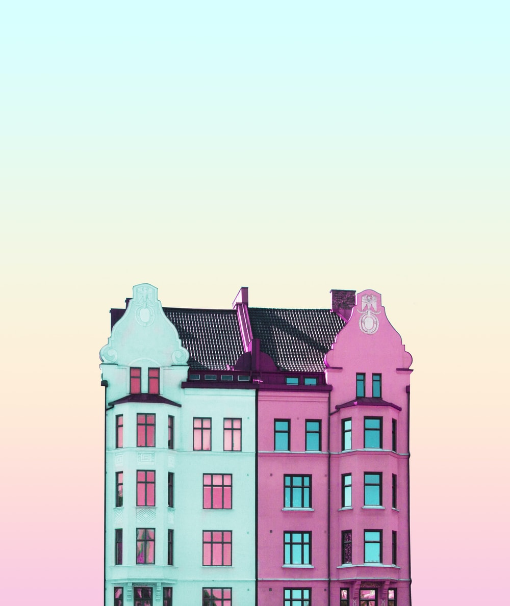 teal, black, and pink high-rise building
