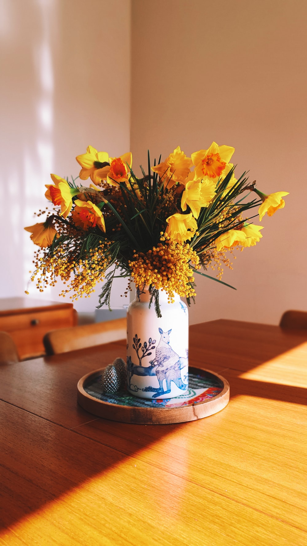 yellow petaled flowers on a vase
