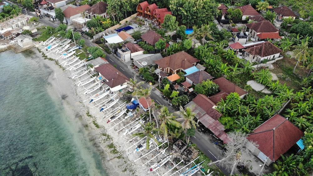 high-angle photography of houses near beach