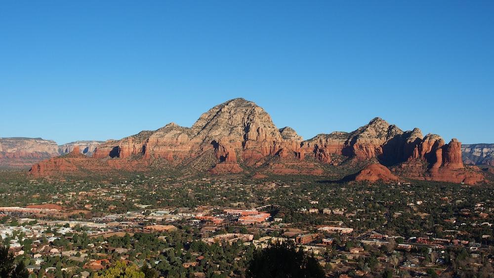 rock mountain under clear sky