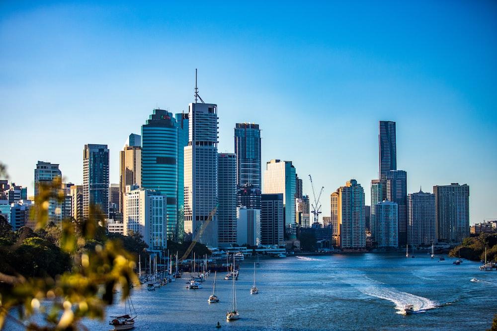 city skyline under clear blue sky during daytime