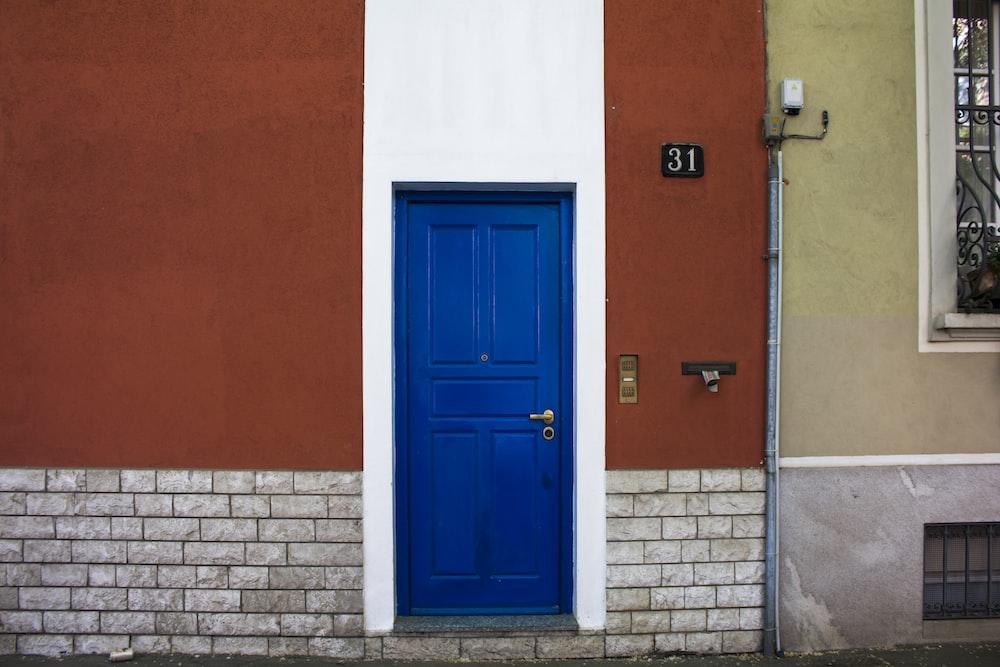 closed blue wooden dor