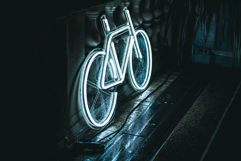 white bicycle neon signage