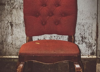 tufted red padded chair